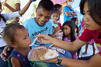 Philippines. Province Eastern Samar. Hernani. Barangay (neighbourhood) Batang. On Hernani's town festival marking the patron's saint's name, a group of children eat rice, noodles and pudding in the rubbles of the Medalla Milagrossa Catholic Church destroyed by typhoon Haiyan's winds and storm surge. Typhoon Haiyan, known as Typhoon Yolanda in the Philippines, was an exceptionally powerful tropical cyclone that devastated the Philippines. Haiyan is also the strongest storm recorded at landfall in terms of wind speed. Typhoon Haiyan's casualties and destructions occured during a powerful storm surge, an offshore rise of water associated with a low pressure weather system. Storm surges are caused primarily by high winds pushing on the ocean's surface. The wind causes the water to pile up higher than the ordinary sea level. 27.11.13 © 2013 Didier Ruef