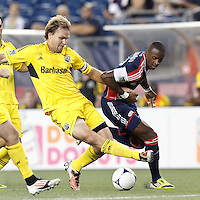 Columbus Crew defender Chad Marshall (14) disrupts an attack. New England Revolution forward Dimitry Imbongo (92). In a Major League Soccer (MLS) match, the New England Revolution defeated Columbus Crew, 2-0, at Gillette Stadium on September 5, 2012.