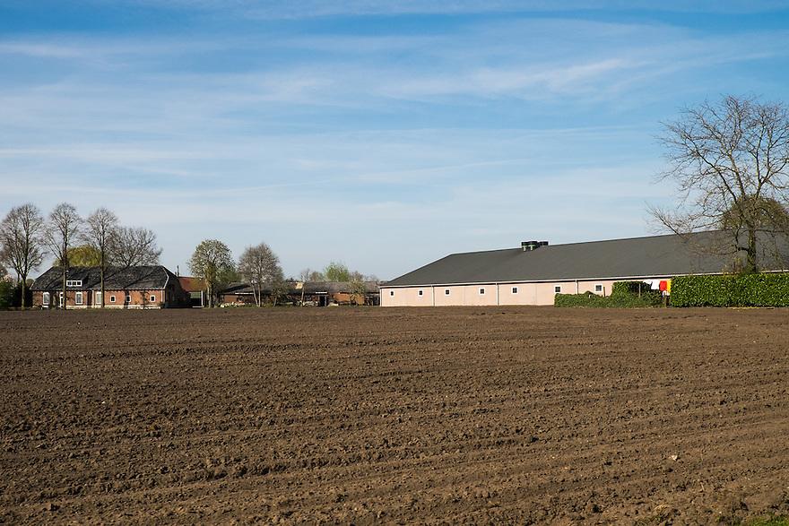 Nederland, omgev. Boekel / Gemert, 20 april 2015<br /> Grote stallen en voedersilo's.<br /> <br /> Foto: Michiel Wijnbergh