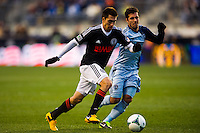 Michael Farfan (21) of the Philadelphia Union is defended by Benny Feilhaber (10) of Sporting Kansas City during the second half . Sporting Kansas City defeated the Philadelphia Union 3-1 during a Major League Soccer (MLS) match at PPL Park in Chester, PA, on March 2, 2013.