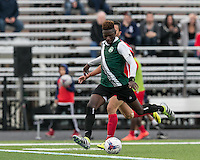 Malden, Massachusetts - July 10, 2016:  In a  National Premier Soccer League (NPSL) match, Greater Lowell United (green/black) defeated Boston City FC (red), 2-1, at Brother Gilbert Stadium on Donovan Field.