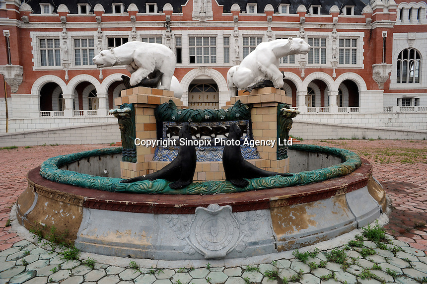A lavish fountain outside another monumental theme building rots in Holland Village, a 220-hectare re-creation of a Dutch city on the outskirts of Shenyang lies in ruins as a monument to corruption in China. Yang Bing, a Dutch passport, got hooked on Holland while studying at Leiden University. Yang bing who built the village with some of ill gotten billions now languishes in jail and the town that is composed of several monumental buildings, plus windmills, artificial lakes, canal a fullsize scooner, 1400 luxury apartments and even an indoor beach are rotting. (see text for more information)