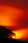 Lava flow entering the Pacific Ocean at night, Hawaii Volcanoes National Park, The Big Island,  Hawaii USA
