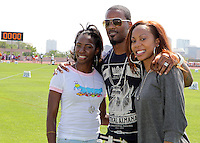 Melaine Walker, Aaron Ross and Sanya Richards-Ross at the 84th. Clyde Littlefield Texas Relays on Saturday, April 9th. 2011. Photo by Errol Anderson