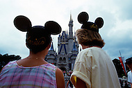Orlando, Florida - Circa 1986. Visitors admire Cinderella's Castle at the Magic Kingdom in Disney World. Disney World is a world-renowned entertainment complex that opened October 1, 1971 in Lake Buena Vista, FL. Now known as the Walt Disney World Resort, the property covers 25,000 acres and has an annual attendance of 52.5million people.