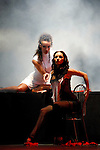 Expressive stage performance Two young attracting women with expressive poses and looks on a stage with a cloud of smoke behind them Show-ballet troup A-6 play Passion is Stronger Than Love in Kiev Ukraine April 2007