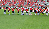 29 June 2013: Real Salt Lake players participate<br /> during the opening ceremonies in an MLS game between Real Salt Lake and Toronto FC at BMO Field in Toronto, Ontario Canada.<br /> Real Salt Lake won 1-0.