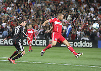 Chris Pontius #13 of D.C. United loses the ball to C.J. Brown #2 of the Chicago Fire during an MLS match on April 17 2010, at RFK Stadium in Washington D.C. Fire won the match 2-0.