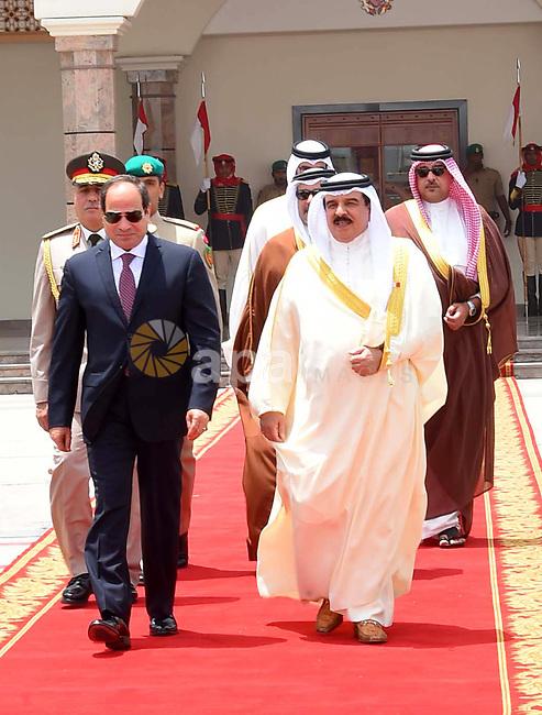 Egyptian President Abdel Fattah al-Sisi walks alongside Bahrain's King Hamad bin Isa Al Khalifa before he leaves Bahrain on May 09, 2017. Photo by Egyptian President Office