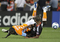 Julius James #2 of D.C. United slides into Dominic Oduro #23 of the Houston Dynamo during an MLS match at RFK Stadium in Washington D.C. on September  25 2010. Houston won 3-1.