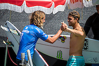 Snapper Rocks, Coolangatta Queensland Australia (Monday, March 14 2016): Matt Wilkinson (AUS)  with Conner Coffin (USA) - Round Two of the first WCT event of the year, the Quiksilver Pro Gold Coast, was completed this morning followed by Round Three and two heats of Round Four.  The upsets continued with the Tour Rookies taking out out a good proportion of the heats with Stu Kennedy(AUS) again showing great form by defeating Gabriel Medina (BRA). The event was put on hold for over 2 hours while organisers waited for the tide to drop. The surf was in the 4'-5' range most of the day.Photo: joliphotos.com