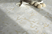 Huelva, a handmade mosaic shown in honed Heavenly Cream, polished Cloud Nine and Thassos, is part of the Miraflores Collection by Paul Schatz for New Ravenna.<br />