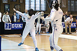 12 February 2017: UNC's Samantha Galina (left) attacks Northwestern's Katie Van Riper (right) in Epee. The University of North Carolina Tar Heels played the Northwestern University Wildcats at Card Gym in Durham, North Carolina in a 2017 College Women's Fencing match. UNC won the dual match 15-12 overall, 5-4 Foil, 5-4 Epee, and 5-4 Saber.