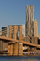 Brooklyn Bridge, designed by John Augustus Roebling,  Beekman Tower, architect Frank Gehry, The Woolworth Building designed by Cass Gilbert, Manhattan, New York City, NY