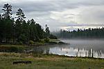 Fog rises from White Horse Lake, Kaibab National Forest, Arizona