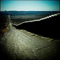 The tall border fence separating California from Mexico near the small town of Campo.