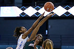 09 November 2015: North Carolina's N'Dea Bryant (left) and Mount Olive's Arieal Johnson (center) challenge for a jump ball. The University of North Carolina Tar Heels hosted the University of Mount Olive Trojans at Carmichael Arena in Chapel Hill, North Carolina in a 2015-16 NCAA Women's Basketball exhibition game. UNC won the game 99-45.
