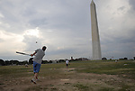 Jon Japha, a Washington D.C. resident, takes some batting practice on the north side of the Washington Monument on August 1, 2011. Japha is a member of the Capitol Alumni Network softball league.