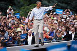BOULDER, CO - SEPTEMBER 2: President Barack Obama makes his way onto stage before speaking at a Grassroots Rally Sunday, September 2 on the University of Colorado campus in Boulder, Colorado. Obama discussed his plan to help the middle class, Obamacare's impact and the importance of the youth of America getting out to vote in the upcoming election. (Photo by Marc Piscotty/ ©2012)