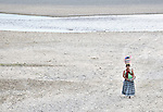 A woman walks home from doing the laundry in a river outside Las Flores, Ixcan, Guatemala.