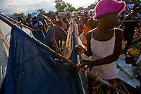 A girl dismantles her tent to make way for larger, more sturdy ones provided by Venezuelan soldiers in Jacmel's Pechinat camp for displaced persons. The 7.0 earthquake that devastated parts of Haiti on January 12 killed hundreds of thousands of people. January's earthquake killed hundreds of thousands of people and caused significant and lasting structural and economic damage in the Caribbean nation.