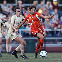 University of Miami forward Kate Howarth (1) dribbles as Boston College defender Zoe Lombard (20) defends..After two overtime periods, Boston College (gold) tied University of Miami (orange), 0-0, at Newton Campus Field, October 21, 2012.