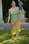 Old Westbury, New York, U.S. - June 21, 2014 - A dancer appears at the Colonnade when Lori Belilove & The Isadora Duncan Dance Company starts to dance throughout the gardens, at the Long Island Gold Coast estate of Old Westbury Gardens on the first day of summer, the summer solstice.