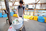 A resident disposes of waste at the waste disposal center in Kamikatsu Town in Shikoku, Japan. The town, whose residents number just over 2,000 people, has implemented a waste recycling policy that aims at eliminating waste entirely within the next 12 years.