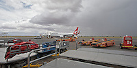 Qantas Boeing 737 preparing to depart Alice Springs (ASP) airport, while a storm passes