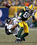 Green Bay Packers' Donald Driver fumbles the ball after being hit by Baltimore Ravens' Chris Carr in the 3rd quarter. .The Green Bay Packers hosted the Baltimore Ravens at Lambeau Field Monday December 7, 2009. Steve Apps-State Journal.