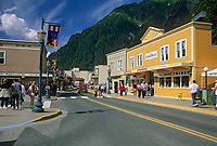 Tourists enjoy a sunny day in downtown Juneau, Alaska.