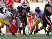 Tony Creecy finds a hole in Cheppewa defense. NC State defeated Central Michigan 38-24 on Saturday, October 8, 2011 at Carter-Finley Stadium in Raleigh. Photo by Al Drago.