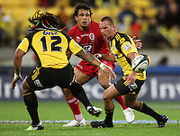 Hurricanes first five Aaron Cruden pops the ball the wrong way for Ma'a Nonu during the Super 14 rugby match between Hurricanes and Reds at Westpac Stadium, Wellington, New Zealand on Friday, 7 May 2010. Photo: Dave Lintott / lintottphoto.co.nz