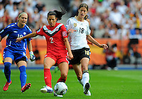 Kerstin Garefrekes (r) of Germany and Erin McLeod (l) and Emily Zurrer of Canada during the FIFA Women's World Cup at the FIFA Stadium in Berlin, Germany on June 26th, 2011.