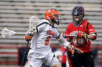 Steele Stanwick (6) of Virginia is defended by Brett Schmidt (44) of Maryland during the ACC men's lacrosse tournament finals in College Park, MD.  Virginia defeated Maryland, 10-6.