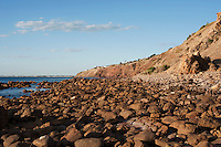The rocky shore is warm in the evening light, Marino Rocks, South Australia.