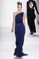 Model walks runway an SAPPHIRE IRIDESCENT SILK CHIFFON DRAPED ONE-SHOULDER GOWN W/ FLOWY BACK PANEL by Zang Toi, for the Zang Toi Spring 2012 My Dream Of North Africa Collection, during Mercedes-Benz Fashion Week Spring 2012.