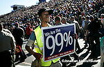 "Members of Occupy The Rose Parade march down Colorado Bl. during the ""We The People"" march immediately following the last official entry in the Rose Parade in Pasadena, California, January 2, 2012. REUTERS/Jonathan Alcorn (UNITED STATES)."