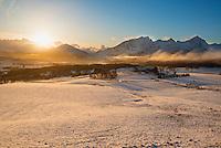 Light spring snow covers farm fields on Vestvagoy, Lofoten Islands, Norway
