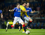 Rangers v St Johnstone...19.11.11   Scottish Premier League.Francisco Sandaza is closed out by Kirk Broadfoot and Carlos Bocanegra.Picture by Graeme Hart..Copyright Perthshire Picture Agency.Tel: 01738 623350  Mobile: 07990 594431