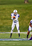 8 October 2016: Amherst College Purple & White Punter Andrew Ferrero, a Sophomore from San Francisco, CA, takes a snap during play against the Middlebury College Panthers at Alumni Stadium in Middlebury, Vermont. The Panthers edged out the Purple & While 27-26. Mandatory Credit: Ed Wolfstein Photo *** RAW (NEF) Image File Available ***