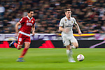"""Toni Kroos of Real Madrid is followed by Paulo Henrique Chagas de Lima """"Ganso"""" of Sevilla FC during their Copa del Rey Round of 16 match between Real Madrid and Sevilla FC at the Santiago Bernabeu Stadium on 04 January 2017 in Madrid, Spain. Photo by Diego Gonzalez Souto / Power Sport Images"""