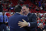 18 February 2017: NC State head coach Mark Gottfried (right) greets Notre Dame head coach Mike Brey (left) before the game. The North Carolina State University Wolfpack hosted the University of Notre Dame Fighting Irish at the PNC Arena in Raleigh, North Carolina in a 2016-17 Division I Men's Basketball game. Notre Dame won the game 81-72.