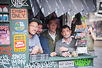 "(L-R) Kimou ""Grotesk"" Meyer, Evan Pricco, Editor Juxtapoz, Chris Isenberg, Editor Victory Journal, and Stephen Benedk, Publisher Victory Journal, pose in the ""T. SQ Newsstand"" in Times Square in New York on Friday, October 9, 2015. Created by the artist Kimou ""Grotesk"" Meyer with Victory Journal and Juxtapoz Magazine, the pop-up displays and sells art and culture zines created by a litany of artists. It will be in business at the crossroads of the world until October 18. (© Richard B. Levine)"