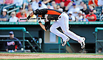 13 March 2012: Miami Marlins infielder Jeff Dominguez attempts to lay down a bunt during a Spring Training game against the Atlanta Braves at Roger Dean Stadium in Jupiter, Florida. The two teams battled to a 2-2 tie playing 10 innings of Grapefruit League action. Mandatory Credit: Ed Wolfstein Photo