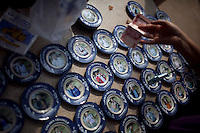 Tourists buy plates with their pictures on them after a boat tour of the Golden Triangle on the Mekong River in Sop Ruak, Thailand. Photo taken on Thursday, December 10, 2009. Kevin German / Luceo Images