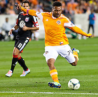 Giles Barnes of the Dynamo, makes an attempt on goal during the second half at BBVA Compass Stadium. Houston beat D.C United, 2-0 in the MLS season opener.