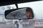 Rush hour traffic looking through windshield at cars break lights in rain Seattle Washington State USA  MR