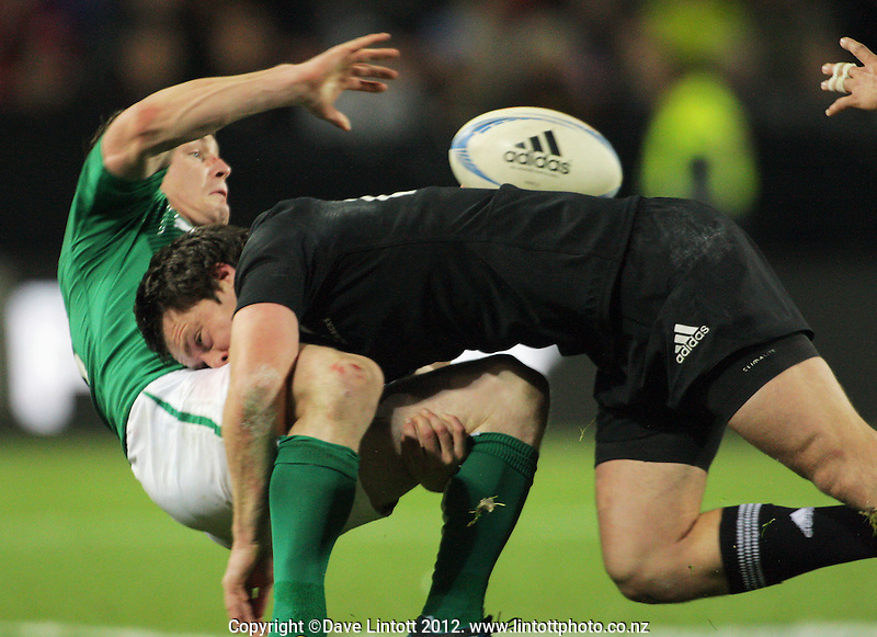 Ben Smith tackles Brian O'Driscoll during the Steinlager Series international rugby test match between All Blacks and Ireland at Waikato Stadium, Hamilton, New Zealand on Saturday, 23 June 2012. Photo: Dave Lintott / lintottphoto.co.nz