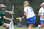 22 February 2015: Duke's Chelsea Landon (7) scores a goal past William & Mary's Alex Lista (left). The Duke University Blue Devils hosted the College of William & Mary Tribe on the West Turf Field at the Duke Athletic Field Complex in Durham, North Carolina in a 2015 NCAA Division I Women's Lacrosse match. Duke won the game 17-7.